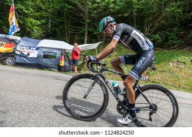 Mont du Chat, France - July 9, 2017: The German cyclists Emanuel Buchmann of Bora-Hansgrohe Team climbing the road on Mont du Chat during the stage 9 of Tour de France 2017.