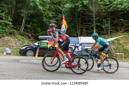 Mont du Chat, France - July 9, 2017: Alessandro De Marchi, Amael Moinard of BMC Team and Bakhtiyar Kozhatayev of Team Astana climbing the road on Mont du Chat during the stage 9 of Tour de France 2017