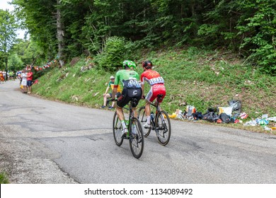 Mont du Chat, France - July 9, 2017: Pierre Rolland of Cannondale-Drapac Pro Cycling Team and Nicolas Edet of Cofidis Team climbing the road on Mont du Chat during the stage 9 of Tour de France 2017.