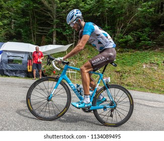 Mont du Chat, France - July 9, 2017: The Luxembourgish cyclists Ben Gastauer of AG2R La Mondiale Team climbing the road on Mont du Chat during the stage 9 of Tour de France 2017.