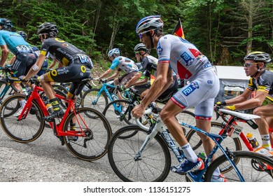 Mont du Chat, France - July 9, 2017: The peloton is climbing the road on Mont du Chat during the stage 9 of Tour de France 2017.