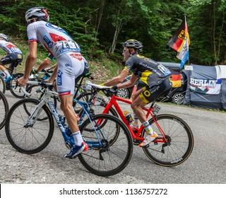 Mont du Chat, France - July 9, 2017: The French cyclist Thibaut Pinot of FDJ Team in  the peloton is climbing the road on Mont du Chat during the stage 9 of Tour de France 2017.