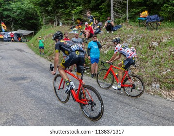 Mont du Chat, France - July 9, 2017: Angelo Tulik and the Polka Dot Jersey, Lilian Calmejane of Direct Energie Team climbing the road on Mont du Chat during the stage 9 of Tour de France 2017.