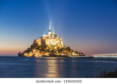 Mont Saint Michel abbey on the island, Normandy, Northern France, Europe in the night