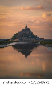 The Mont Saint Michel and its bay at the sunset. Normandy, France