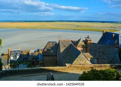 Mont Saint Michel in the evening, roofs, quicksands and water meadows, Normandy, France, Europe