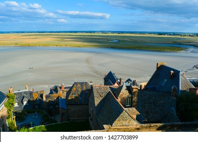 Mont Saint Michel in the evening, roofs, quicksands and meadows, Normandy, France, Europe