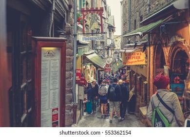 MONT SAINT MICHEL, FRANCE - June 18, 2016: People shopping in the center of Mont Saint-Michel, France