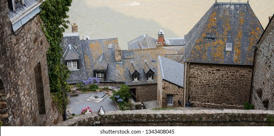 Mont Saint Michel, France. Roofs of old houses in medieval monastery.