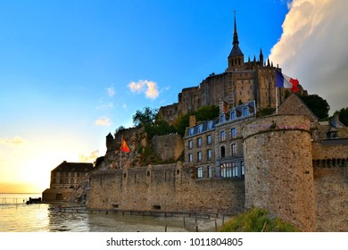Mont Saint Michel at sunset, from outside the walls at high tide, Normandy, France