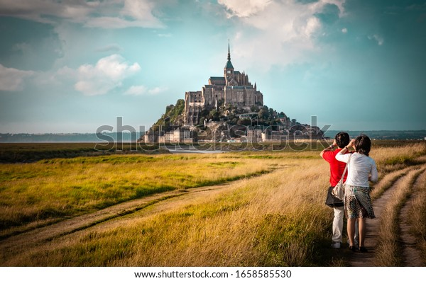 Mont Saint-Michel viewed by chinese tourists, Normandy, France