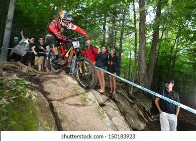 MONT STE-ANNE, QUEBEC, CANADA - AUGUST 11: Downhill Men Elite, 1st place, CAN - SMITH Steve, UCI World Cup on Aug. 11, 2013