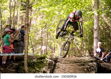 MONT STE-ANNE, QUEBEC, CANADA - AUGUST 11: Downhill Men Junior, CAN - VEZINA McKay about to crash, UCI World Cup on Aug. 11, 2013