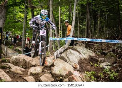 MONT STE-ANNE, QUEBEC, CANADA - AUGUST 11: Downhill Women Elite, 1st place, FRA - RAGOT Emmeline, UCI World Cup on Aug. 11, 2013