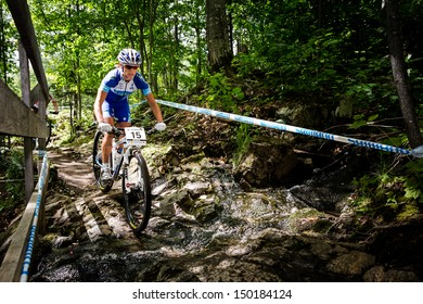 MONT STE-ANNE, QUEBEC, CANADA - August 10: Cross Country Women Elite, 1st place, CZE - NASH Katerina, UCI World Cup on Aug. 10, 2013