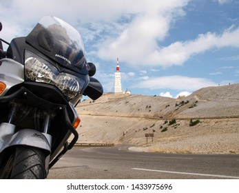 Mont ventoux, France - August 18, 2016: Motorcycle parked on the roadside and in the background Mont Ventoux