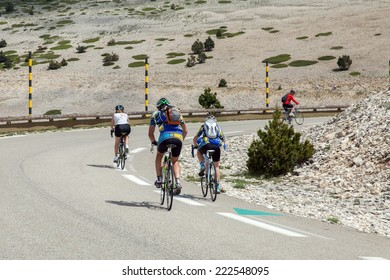 MONT VENTOUX, FRANCE - JUNE 16, 2014: Cyclists on road to top of Ventoux mount in south France
