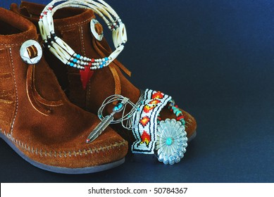 Montage of Native American Moccasins and handcrafted jewelry made from silver, turquoise,beads, antlers,horns, and coral.