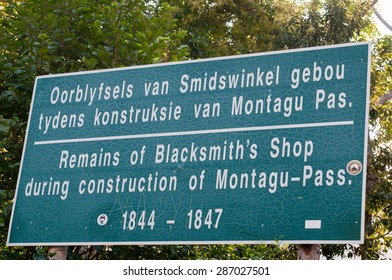 MONTAGU PASS, SOUTH AFRICA - JANUARY 2, 2015: Sign at the site of the historic blacksmith shop in the Montagu Pass