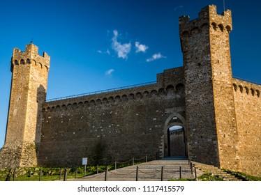 Montalcino castle in evening sunshine in Tuscany