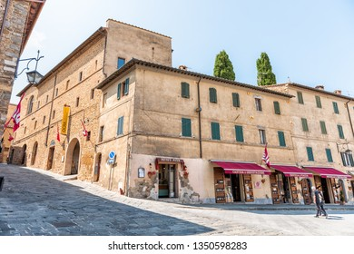 Montalcino, Italy - August 26, 2018: Street steep in town village in Tuscany during summer day and wine store with local Brunello