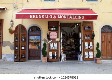 MONTALCINO, ITALY - JULY 20, 2017: Entrance of traditional wine shop in Montalcino, Val d'Orcia, Tuscany, Italy. The town is famous for its Brunello di Montalcino wine.