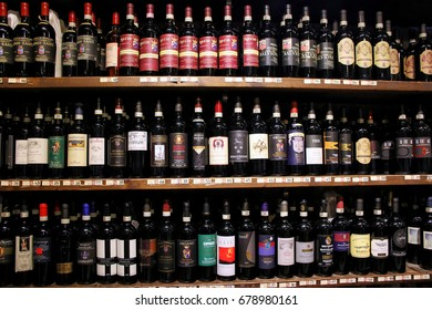 MONTALCINO, ITALY - MAY 10: Display of wine in a shop inside Montalcino Fortress on May10, 2017 in Montalcino, Val d'Orcia, Tuscany, Italy. The town is famous for its Brunello di Montalcino wine.
