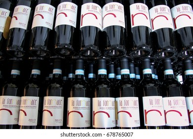 MONTALCINO, ITALY - MAY 19: Display of wine bottles at a winery on May 19, 2015 in Montalcino, Val d'Orcia, Tuscany, Italy. The town is famous for its Brunello di Montalcino wine.