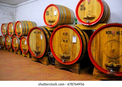 MONTALCINO, ITALY - MAY 19: Wooden barrels in a wine cellar on May 19, 2015 in Montalcino, Val d'Orcia, Tuscany, Italy. The town is famous for its Brunello di Montalcino wine.