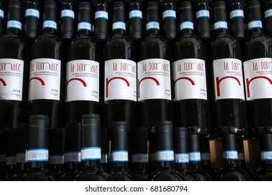 MONTALCINO, ITALY - MAY 9: Display of wine bottles at a winery on May 9, 2017 in Montalcino, Val d'Orcia, Tuscany, Italy. The town is famous for its Brunello di Montalcino wine.