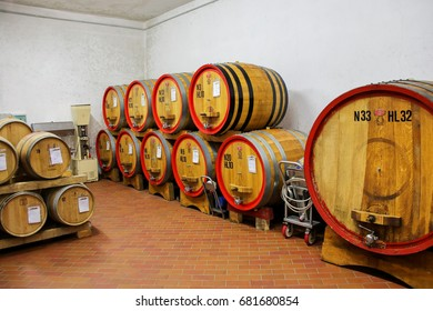 MONTALCINO, ITALY - MAY 9: Wooden barrels in a wine cellar on May 9, 2017 in Montalcino, Val d'Orcia, Tuscany, Italy. The town is famous for its Brunello di Montalcino wine.
