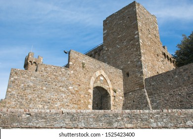 MONTALCINO, ITALY - OCTOBER 4, 2019:  ancient medieval gate of the defensive walls of the fortress of Montalcino in Tuscany. The town is known for the production of the famous Brunello wine