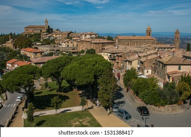 MONTALCINO, ITALY - OCTOBER 4, 2019: Sunny day over the roofs of the old Montalcino town