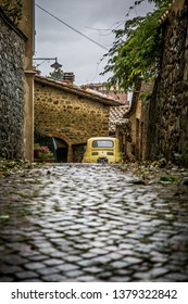 MONTALCINO, TOSCANA/ITALY - 28 OCTOBER 2018: Street of the ancient town of Montalcino in Tuscany. Fiat 500 parked in an alley. Tuscany, Italy