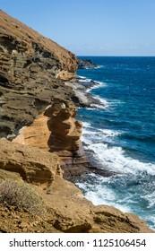 Montana Amarilla rocks and Atlantic ocean shore, Tenerife islans, Spain.