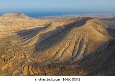 Montana Blanca and Montana Negra at Villaverde, Fuerteventura, Spain. Aerial drone view in october 2019