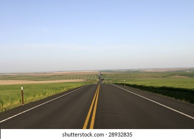 Montana highway with fields on both sides
