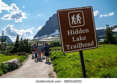 Montana, USA - July 28, 2020: Crowds of hikers gather at the Hidden Lake Trailhead, a very popular easy hike in Logan Pass area of Glacier National Park