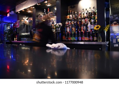 MONTANA, USA - September 9, 2018: Bartender in motion working behind a bar