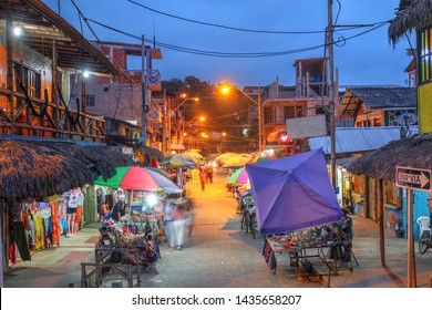 Montanita, Ecuador - June 26, 2018: Night scene with street market in the small surfing resort town of Montanita, Ecuador