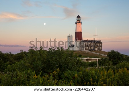 Montauk Lighthouse at sunset with the moon