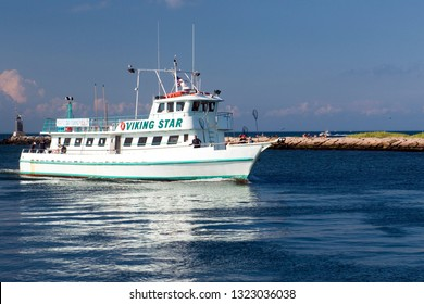 MONTAUK, NEW YORK-AUGUST 14: The fishing party charter boat Viking Star is seen entering Montauk Harbor in Montauk, New York, Long Island in the Hamptons on August 14, 2018.