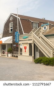 MONTAUK, NEW YORK-JULY 12: The entry to Topside restaurant at Gosman's dock is seen in The Hamptons, Montauk, New York on July 12, 2017.