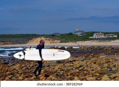 MONTAUK, NEW YORK-JUNE 13: Unidentified senior surfer with surfboard on Ditch Plains surfing beach, Altantic Ocean is seen on June 13, 2015.