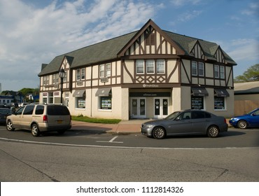 MONTAUK, NEW YORK-JUNE 8: English Tudor style architecture is seen on historic Fisher inspired building in village green downtown Montauk, New York, The Hamptons on June 8, 2018.
