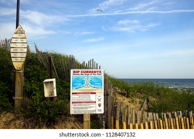 MONTAUK, NEW YORK-JUNE 8:  Rip current warning and surfer rules signs are seen on Ditch Plains Beach, Montauk, New York, Long Island in The Hamptons on June 8, 2018.