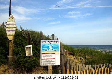 MONTAUK, NEW YORK-JUNE 8:  Signs showing rip current warning and surfer rules are seen on beach dunes in The Hamptons, Montauk, New York on Dirtch Plains Beach on June 8, 2018.