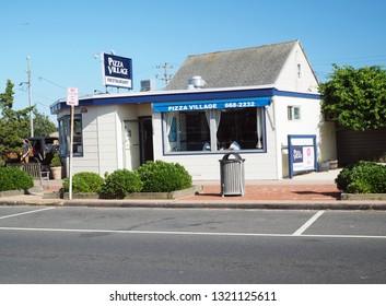 MONTAUK, NEW YORK/USA-JUlY 12: The landmark Pizza Village restaurant is seen on Main St. in Montauk, New York, The Hamptons, USA  on July 12, 2018.