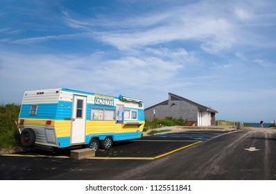 MONTAUK, NY-JUNE 8: A lemonade and ice cream wagon is seen in parking lot in Montauk, New York by popular surfing Ditch Plains Beach on June 8,2018.