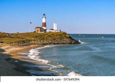 Montauk Point Lighthouse and beach from the cliffs of Camp Hero. Long Island, New York